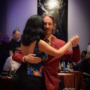 Marcelo Solis dancing Argentine Tango with Paulita at a milonga in Buenos Aires.